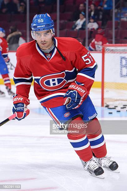 Francis Bouillon of the Montreal Canadiens skates during the the warm up period prior to facing the Florida Panthers in their NHL game at the Bell...
