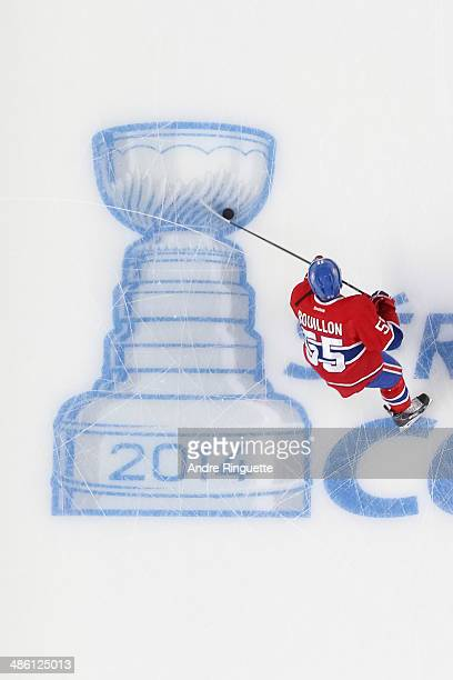 Francis Bouillon of the Montreal Canadiens skates over the Stanley Cup logo during warmup prior to playing against the Tampa Bay Lightning in Game...