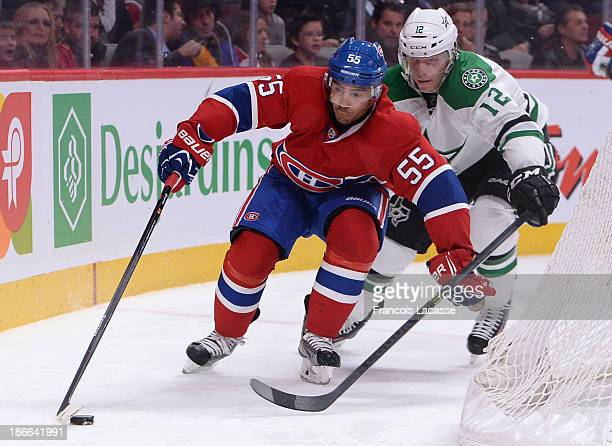 Francis Bouillon of the Montreal Canadiens stickhandles the puck away from Alex Chiasson of the Dallas Stars during the NHL game on October 29 2013...