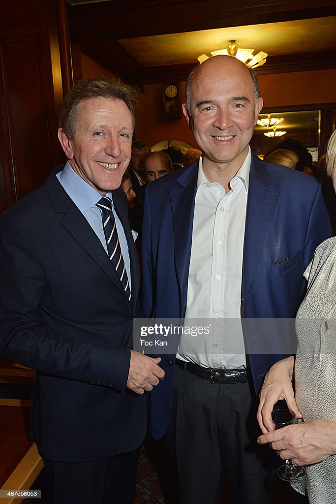 Francis Boussard and Pierre MoscoviciÊattend the Francis Boussard's and Nadine Carpentier's : Private Cocktail At Cafe de Flore on April 30, 2014 in Paris, France.