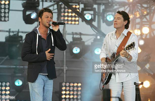 Francis Cabrel and Christophe Mae perform at the France 2 Television's 'Fete de la Musique' at the Auteuil Horse track on June 21 2008 in Paris France