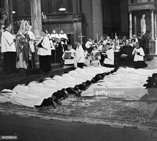 Francis Cardinal Spellman administers his blessing to sixteen members of the Paulist Fathers as they lie prostrate before him May 3rd at the Paulist...