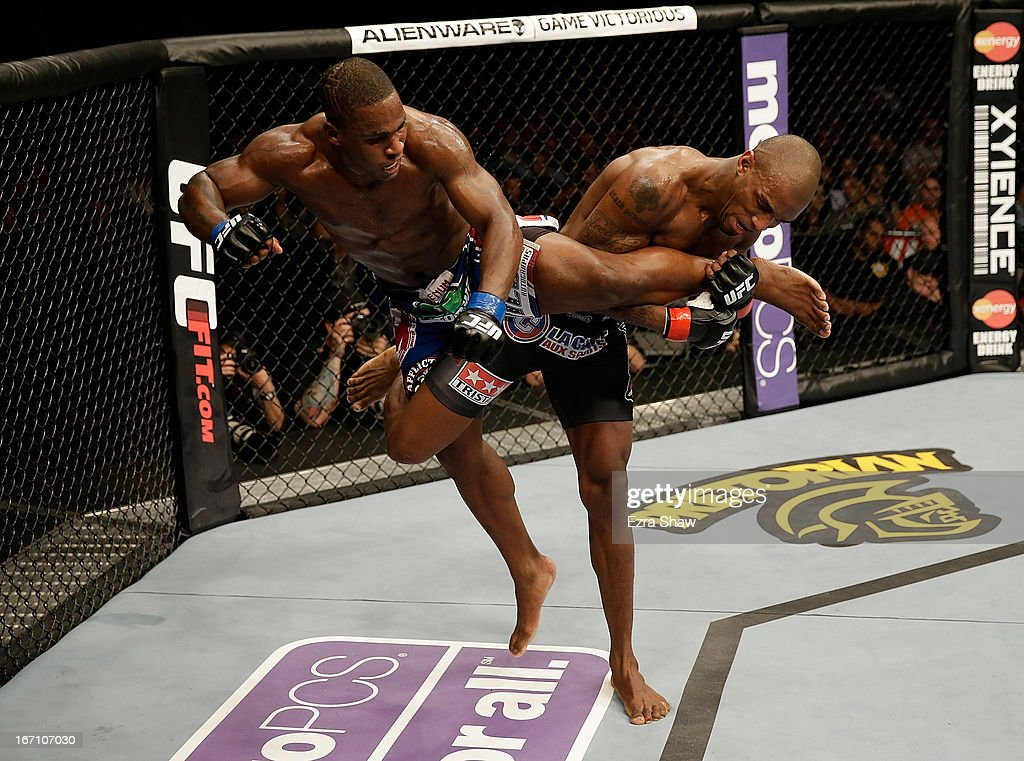 Francis Carmont trips Lorenz Larkin in their middleweight bout during the UFC on FOX event at the HP Pavilion on April 20, 2013 in San Jose, California.
