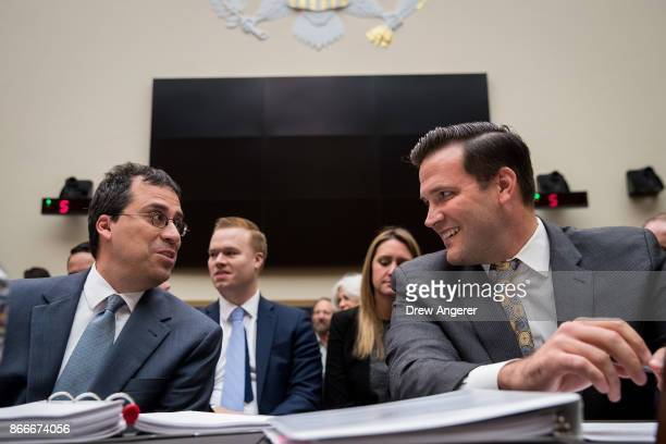 Francis Cissna director of US Citizenship and Immigration Services at the US Department of Homeland Security talks with Scott Lloyd director of the...