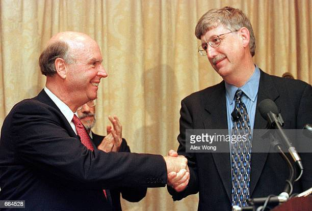 Francis Collins right Director of the National Human Genome Research Institute NIH shakes hands with J Craig Venter President and Chief Scientific...