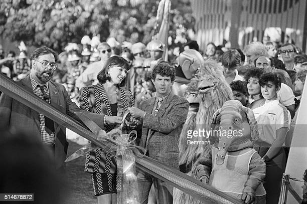 Francis Coppola Anjelica Huston and George Lucas join in the ribboncutting ceremony to open Captain Eo threedimensional film from Disney starring...