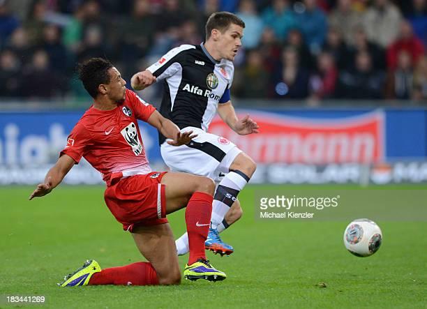 Francis Coqelin of Freiburg challenges Sebastian Jung of Frankfurt during the Bundesliga match between SC Freiburg and Eintracht Frankfurt at Mage...