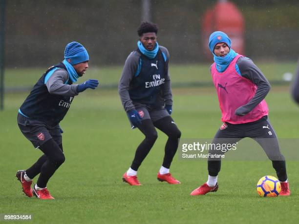 Francis Coquelin Ainsley MaitlandNiles and Jack Wilshere of Arsenal during a training session at London Colney on December 27 2017 in St Albans...