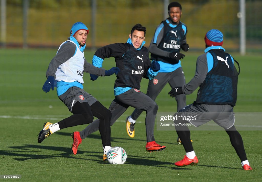 Francis Coquelin, Alexis Sanchez and Alex Lacazette of Arsenal during a training session at London Colney on December 18, 2017 in St Albans, England.
