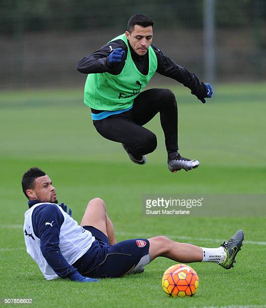 Francis Coquelin and Alexis Sanchez of Arsenal during a training session at London Colney on February 1, 2016 in St Albans, England.
