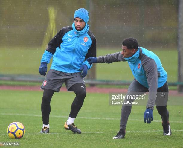 Francis Coquelin and Jeff ReineAdelaide of Arsenal during a training session at London Colney on January 2 2018 in St Albans England