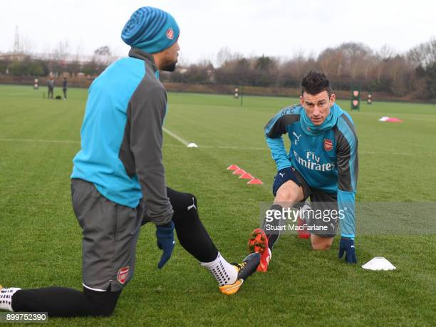 Francis Coquelin and Laurent Koscielny of Arsenal during a training session at London Colney on December 30 2017 in St Albans England