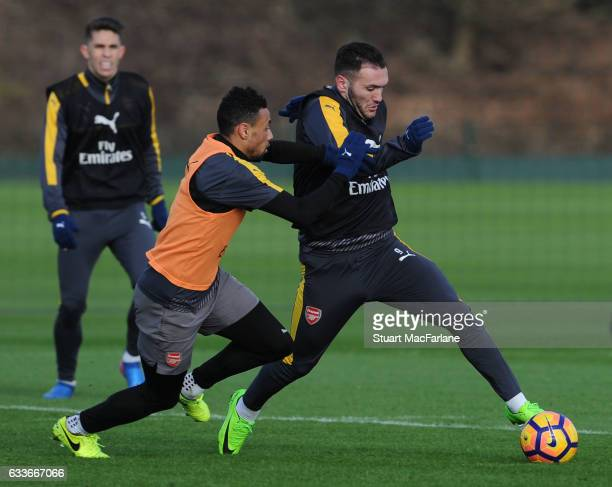 Francis Coquelin and Lucas Perez of Arsenal during a training session at London Colney on February 3 2017 in St Albans England