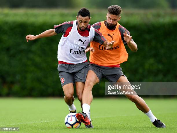 Francis Coquelin and Olivier Giroud of Arsenal during a training session at London Colney on August 24, 2017 in St Albans, England.