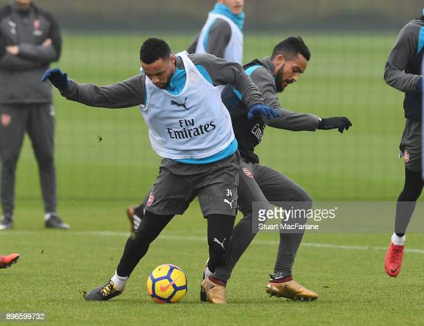 Francis Coquelin and Theo Walcott of Arsenal during a training session at London Colney on December 21 2017 in St Albans England
