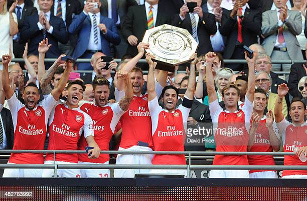 Francis Coquelin, Hector Bellerin, Olivier Giroud, Per Mertesacker, Mikel Arteta and Nacho Monreal of Arsenal lift the Community Shield after the FA...