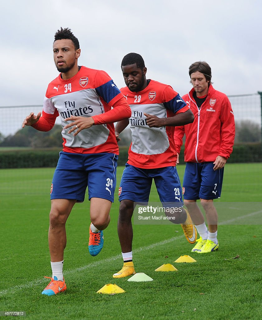 Francis Coquelin, Joel Campbell and Tomas Rosicky of Arsenal attend a training session at London Colney on October 24, 2014 in St Albans, England.