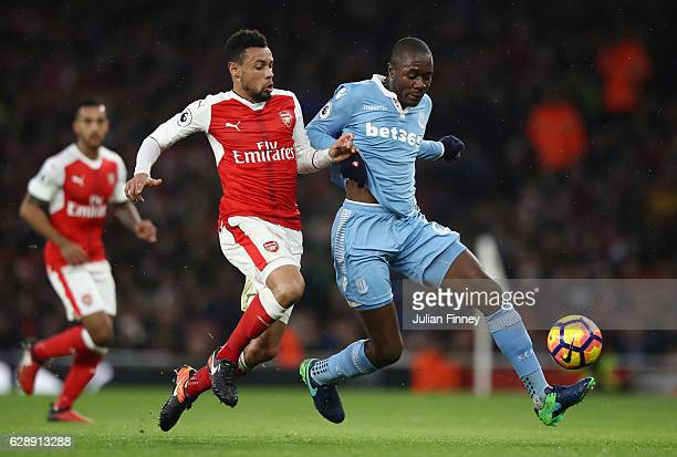 Francis Coquelin of Arsenal and Gianelli Imbula of Stoke City battle for possession during the Premier League match between Arsenal and Stoke City at...
