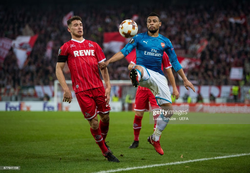 Francis Coquelin (R) of Arsenal and Salih Oezcan (L) of Koeln fight for the ball during the UEFA Europa League group H match between 1. FC Koeln and Arsenal FC at RheinEnergieStadion on November 23, 2017 in Cologne, Germany.