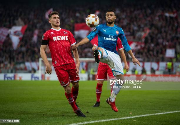 Francis Coquelin of Arsenal and Salih Oezcan of Koeln fight for the ball during the UEFA Europa League group H match between 1. FC Koeln and Arsenal...