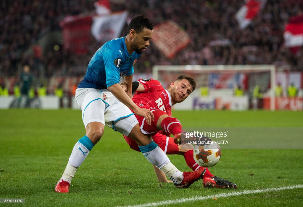 Francis Coquelin (L) of Arsenal and Salih Oezcan (R) of Koeln fight for the ball during the UEFA Europa League group H match between 1. FC Koeln and Arsenal FC at RheinEnergieStadion on November 23, 2017 in Cologne, Germany.
