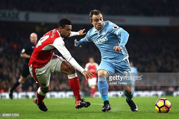 Francis Coquelin of Arsenal and Xherdan Shaqiri of Stoke City battle for possession during the Premier League match between Arsenal and Stoke City at...