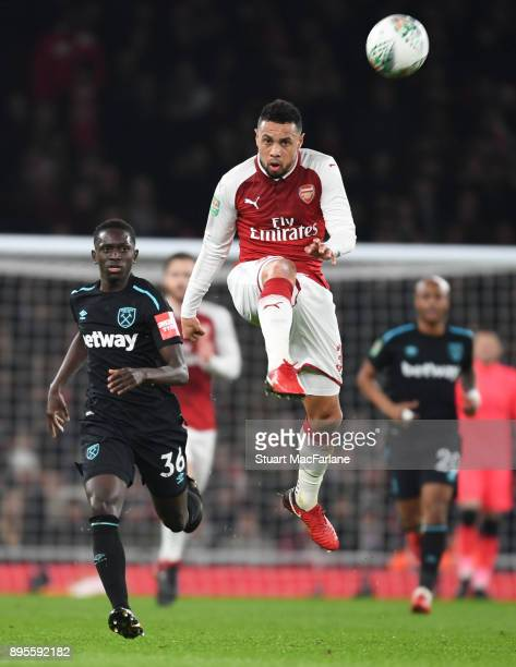 Francis Coquelin of Arsenal breaks past Domingos Quina of West Ham during the Carabao Cup Quarter Final match between Arsenal and West Ham United at...
