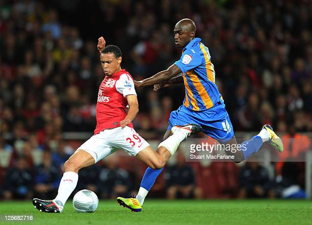 Francis Coquelin of Arsenal breaks past Marvin Morgan of Shrewsbury during the Carling Cup Third Round match between Arsenal and Shrewsbury Town at...