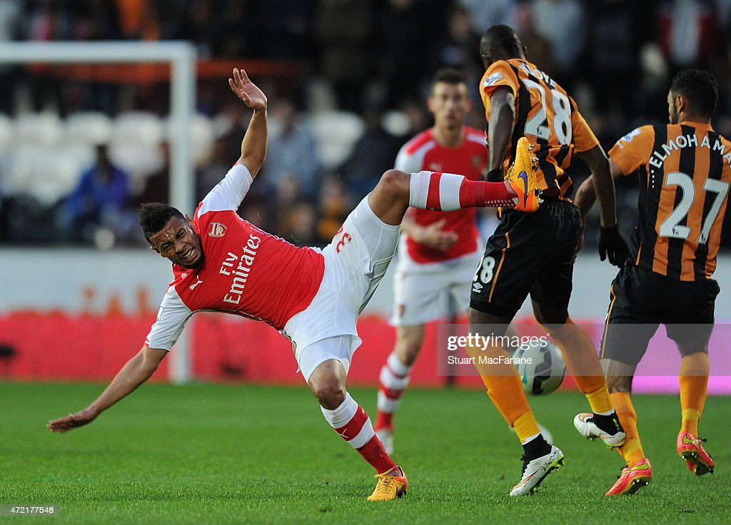 Francis Coquelin of Arsenal challenged by Dame N'Doye of Hull during the Barclays Premier League match between Hull City and Arsenal at KC Stadium on May 4, 2015 in Hull, England.