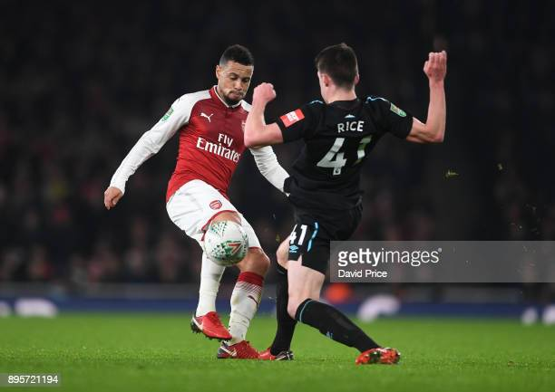 Francis Coquelin of Arsenal challenges Declan Rice of West Ham during the Carabao Cup Quarter Final match between Arsenal and West Ham United at...