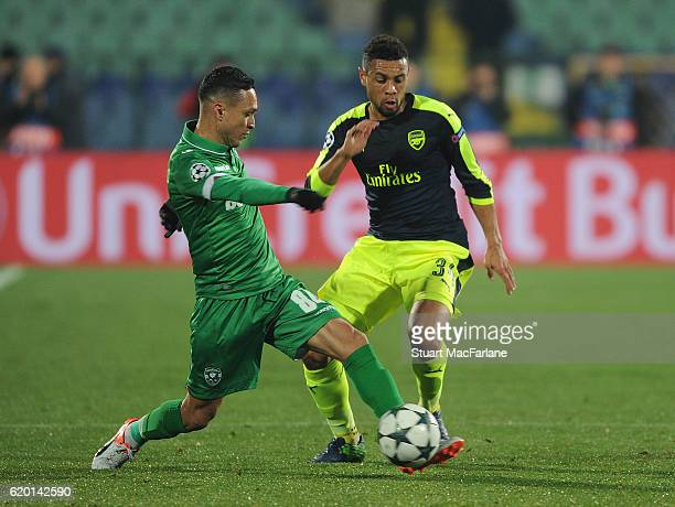 Francis Coquelin of Arsenal challenges Marcelinho of Ludogorets during the UEFA Champions League match between PFC Ludogorets Razgrad and Arsenal FC...
