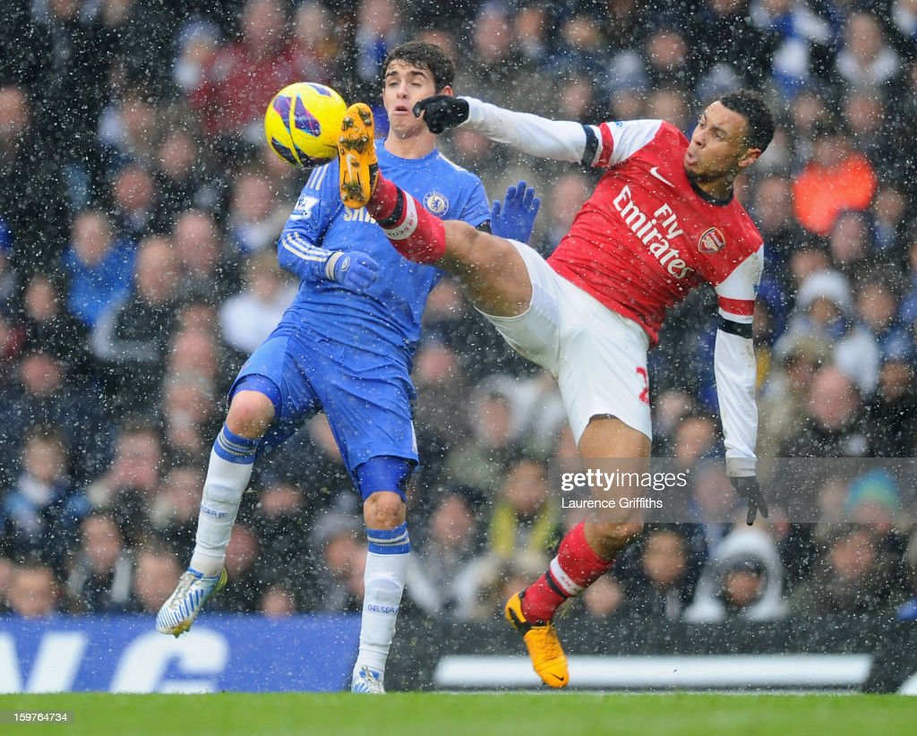 Francis Coquelin of Arsenal challenges Oscar of Chelsea during the Barclays Premier League match between Chelsea and Arsenal at Stamford Bridge on January 20, 2013 in London, England.