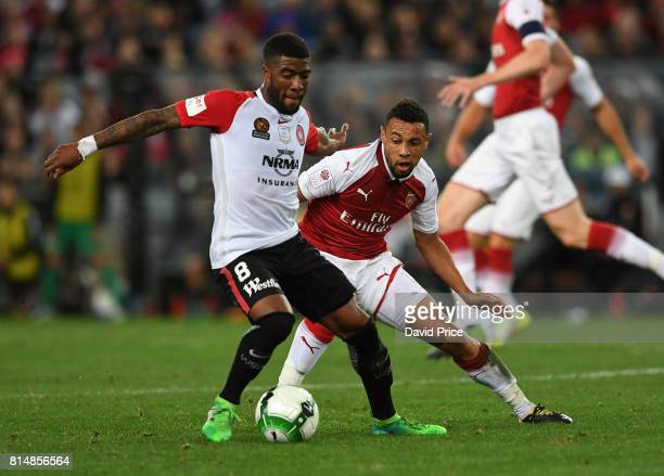 Francis Coquelin of Arsenal closes down Roly Bonevacia of Western Sydney during the match between the Western Sydney Wanderers and Arsenal FC at ANZ...