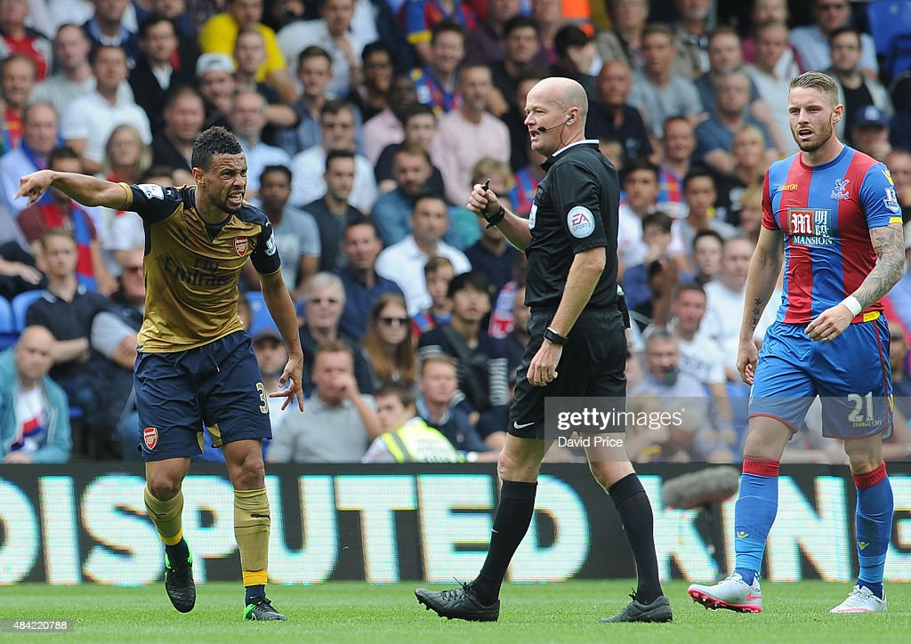Francis Coquelin of Arsenal complains to the referee Lee Mason during the Barclays Premier League match between Crystal Palace and Arsenal on August 16, 2015 in London, United Kingdom.