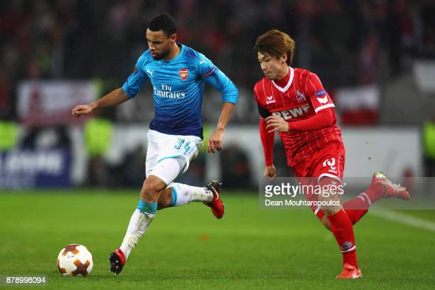 Francis Coquelin of Arsenal gets past Yuya Osako of Koeln during the UEFA Europa League group H match between 1 FC Koeln and Arsenal FC at...