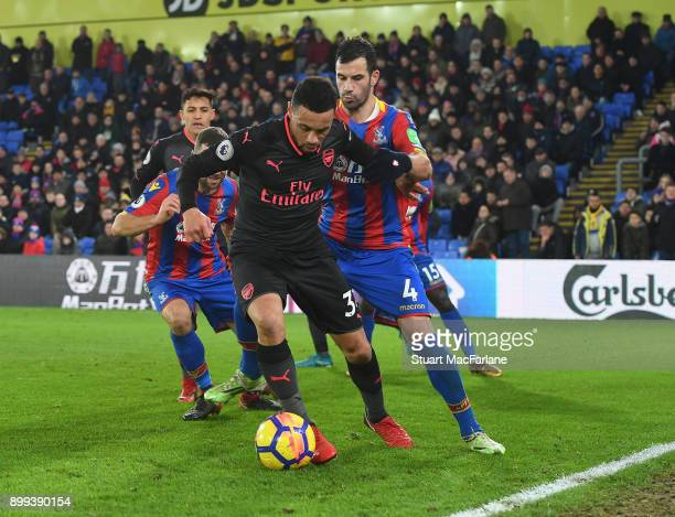 Francis Coquelin of Arsenal holds off Luka Milivojevic of Palace during the Premier League match between Crystal Palace and Arsenal at Selhurst Park...