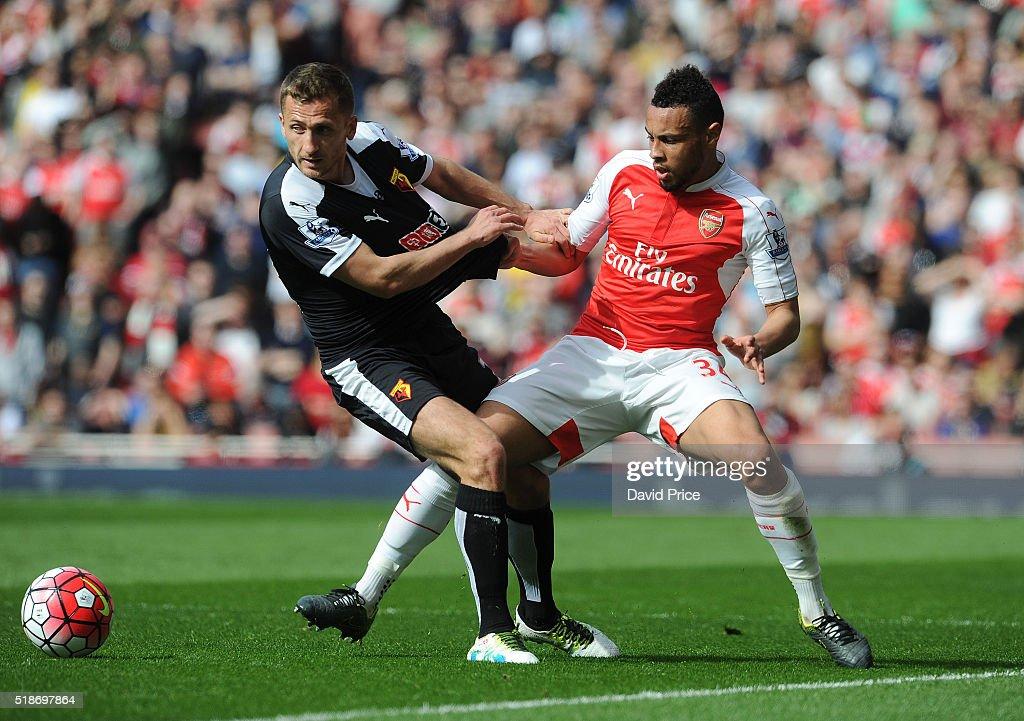 Francis Coquelin of Arsenal is challenged by Almen Abdi of Watford during the Barclays Premier League match between Arsenal and Watford at Emirates Stadium on April 2nd, 2016 in London, England