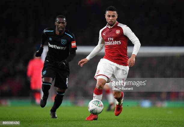 Francis Coquelin of Arsenal is chased by Pedro Obiang of West Ham United during the Carabao Cup QuarterFinal match between Arsenal and West Ham...