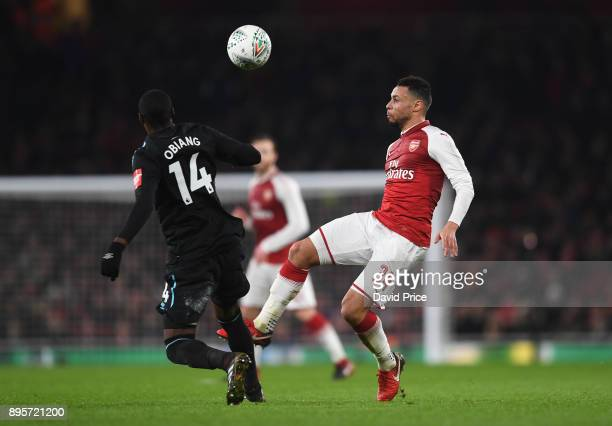 Francis Coquelin of Arsenal knocks the ball over Pedro Obiang of West Ham during the Carabao Cup Quarter Final match between Arsenal and West Ham...