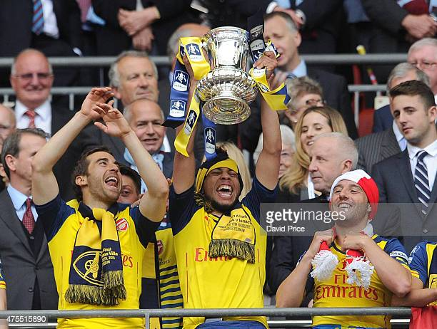 Francis Coquelin of Arsenal lifts the FA Cup Trophy after the match between Arsenal and Aston Villa in the FA Cup Final at Wembley Stadium on May 30...