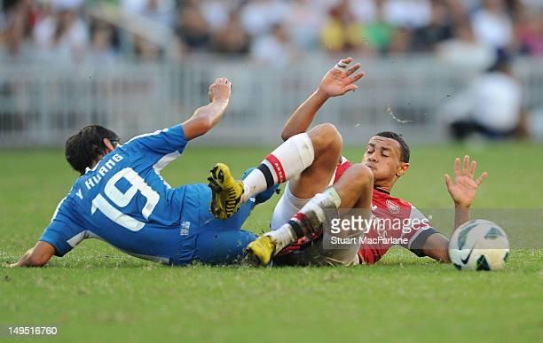 Francis Coquelin of Arsenal tackles Huang Yang of Kitchee during the pre-season Asian Tour friendly match between Kitchee FC and Arsenal at Hong Kong...