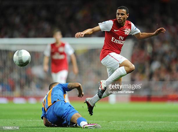 Francis Coquelin of Arsenal takes on Lionel Ainsworth of Shrewsbury during the Carling Cup Third Round match between Arsenal and Shrewsbury Town at...