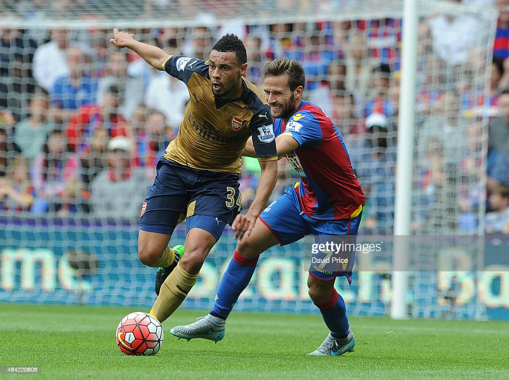 Francis Coquelin (L) of Arsenal takes on Yohan Cabaye of Crystal Palace during the Barclays Premier League match between Crystal Palace and Arsenal on August 16, 2015 in London, United Kingdom.