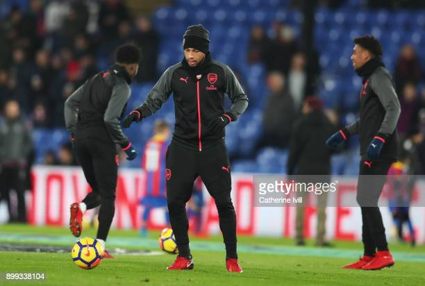 Francis Coquelin of Arsenal warms up with team mates prior to the Premier League match between Crystal Palace and Arsenal at Selhurst Park on...