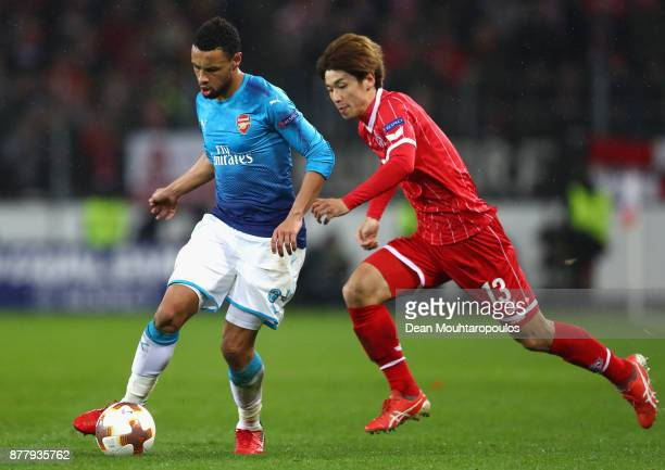 Francis Coquelin of Arsneal and Yuya Osako of FC Koeln in action during the UEFA Europa League group H match between 1 FC Koeln and Arsenal FC at...