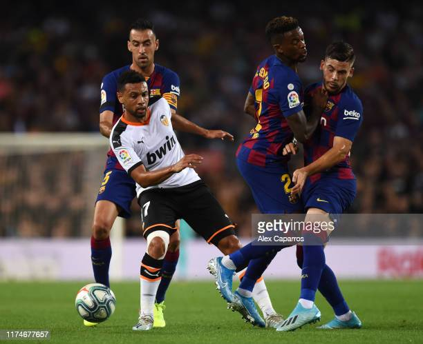 Francis Coquelin of Valencia battles with Sergio Busquets Nelson Semedo and Carles Perez of Barcelona during the Liga match between FC Barcelona and...