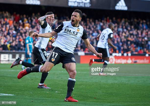 Francis Coquelin of Valencia celebrates after Santi Mina of Valencia scoring a goal during the La Liga match between Valencia and Real Madrid at...