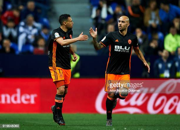 Francis Coquelin of Valencia celebrates with his teammate Simone Zaza of Valencia after scoring the opening goal during the La Liga match between...