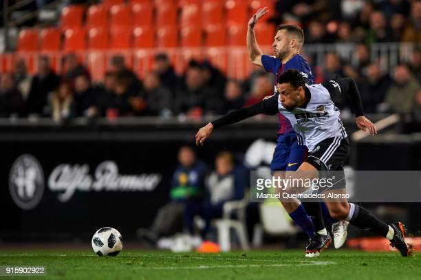 Francis Coquelin of Valencia CF competes for the ball with Jordi Alba of FC Barcelona during the Copa de Rey semifinal second leg match between...