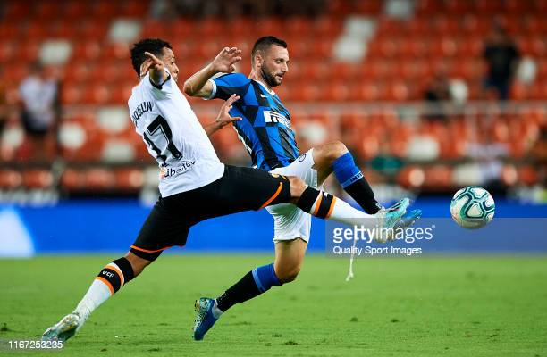 Francis Coquelin of Valencia CF competes for the ball with Marcelo Brozovic of FC Internazionale during a PreSeason Friendly match between Valencia...